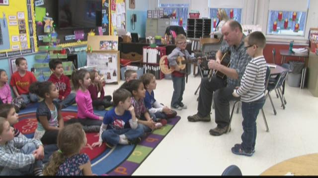 Social worker, Bryan Litchfield, uses music to help students express their feelings and emotions at the John F Kennedy Kindergarten Center.