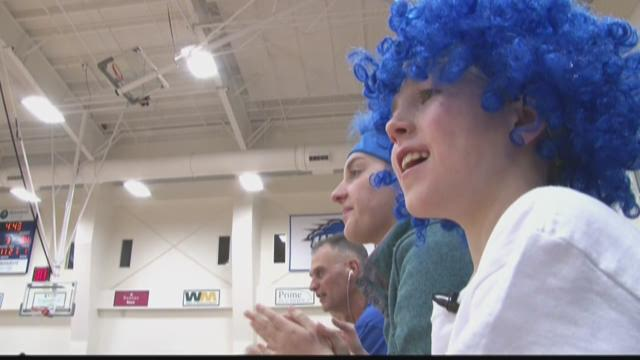 You can't miss Seamus Jennings when he's cheering from the sidelines for the UNE women's basketball team. Last month players returned the favor.