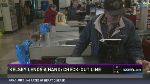Kelsey lends a hand: Check-out line
