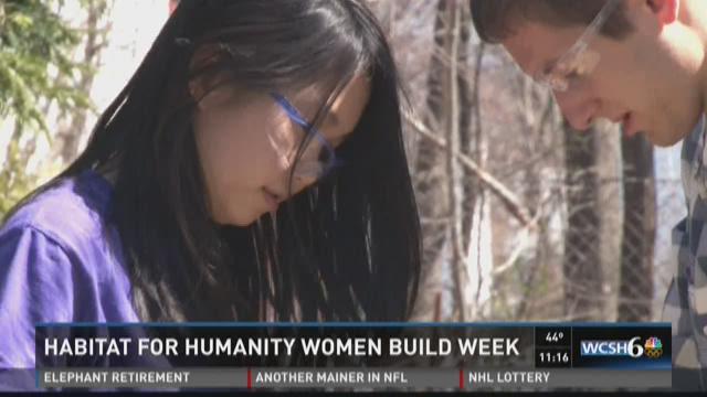 Civil engineers pickup hammer during National Women Build Week